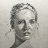 Woman in Sun - Charcoal on toned grey paper.